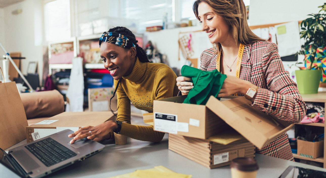 Sales Online. Working women at their store. They accepting new orders online and packing merchandise for customer.